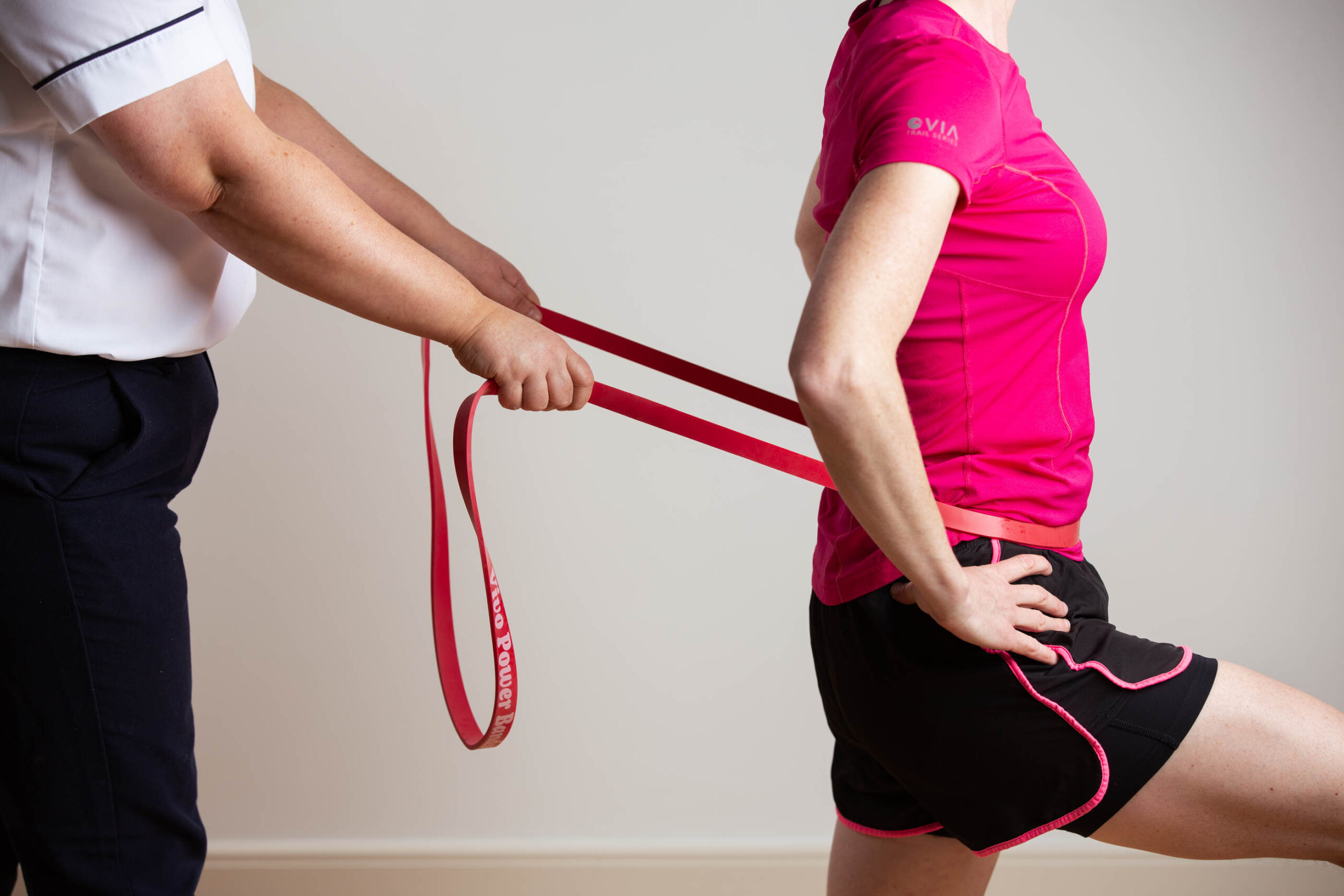 Woman Pulled with Resistance Bands Physiotherapy